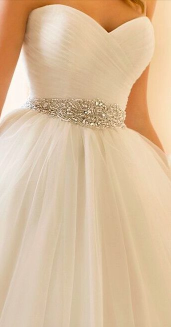Classic sweet heart wedding dress with tulle skirt and silver beaded waist band