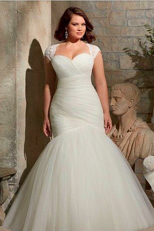 Figure hugging mermaid tulle wedding dress with lace straps