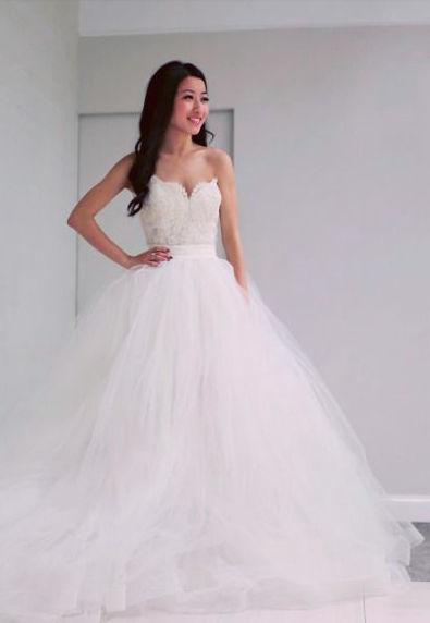 Stunning white ball gown tulle wedding dress